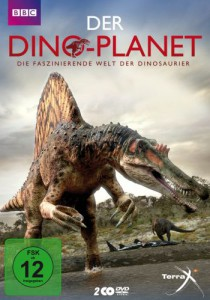 Das Cover der DVD Der Dino-Planet - Die faszinierende Welt der Dinosaurier zeigt einen zweibeinigen Dinosaurier mit einem krokodilähnlichen Kopf und Rückensegel, der mit den Füßen in einem Fluß steht.