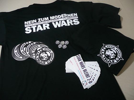 Star Wars Ultras Merch: Schwarze T-Shirts, Sticker und Buttons mit dem weißen Logo (Stromtrooperhelm und SWU-Schriftzug)