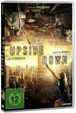 Das Cover von Upside Down. Oben und unten ragen Stadtlandschaften ins Bild. Unten steht eine Frau, oben ein Mann, der kopfunter hängt. Beide strecken einen Arm zum jeweils anderen aus.
