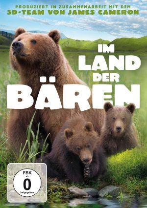 Cover von Im Land der Bären DVD - Eine Bärin mit ihren zwei Jungen in der Wildnis, direkt am Ufer eines Gewässers.