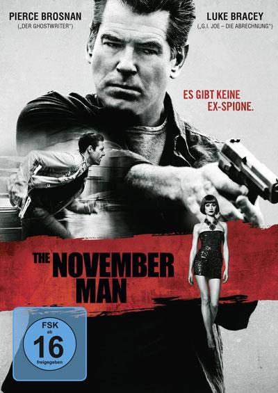 Cover von The November Man. Zu sehen sind Pierce Brosnan mit einer Pistole in der Hand, ein rennender junger Mann und eine Frau im kurzen Rock.