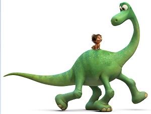 Ein grüner vierbeiniger Dinosaurier, auf seinem Rücken ein Menschenkind.